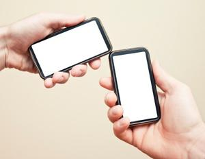 two hands with smartphones