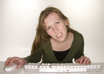 confused woman looking at the editorial calendar for her business blog